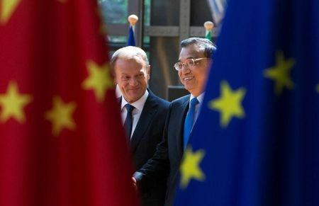 EU Council President Tusk and Chinese Premier Li Keqiang arrive to attend a EU-China Summit in Brussels