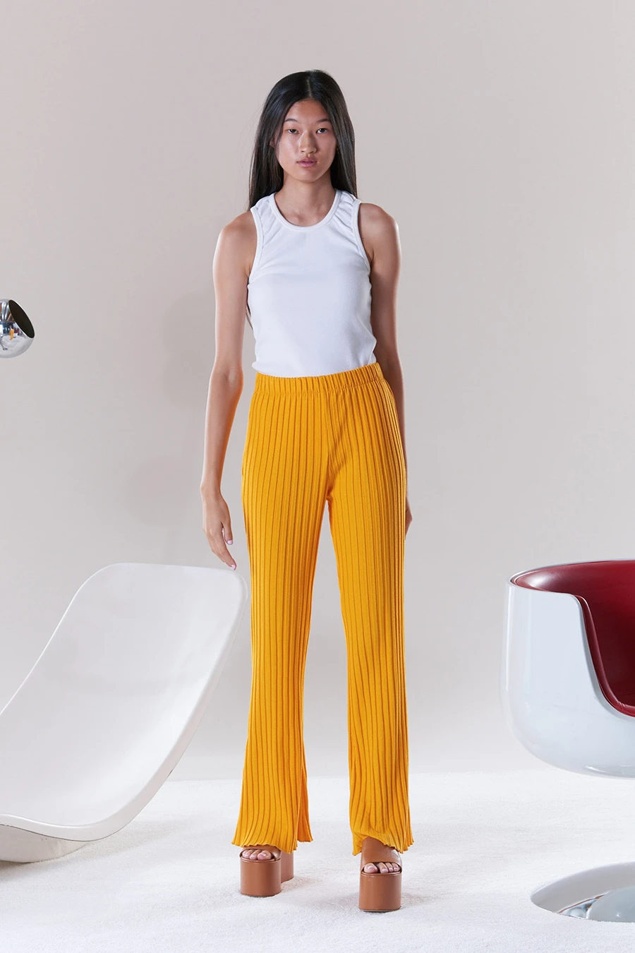 """<br><br><strong>Simon Miller</strong> Rib Cyrene Pant, $, available at <a href=""""https://go.skimresources.com/?id=30283X879131&url=https%3A%2F%2Fwww.simonmillerusa.com%2Fcollections%2Frib-bottoms%2Fproducts%2Frib-cyrene-pant-in-sunset-orange"""" rel=""""nofollow noopener"""" target=""""_blank"""" data-ylk=""""slk:Simon Miller"""" class=""""link rapid-noclick-resp"""">Simon Miller</a>"""