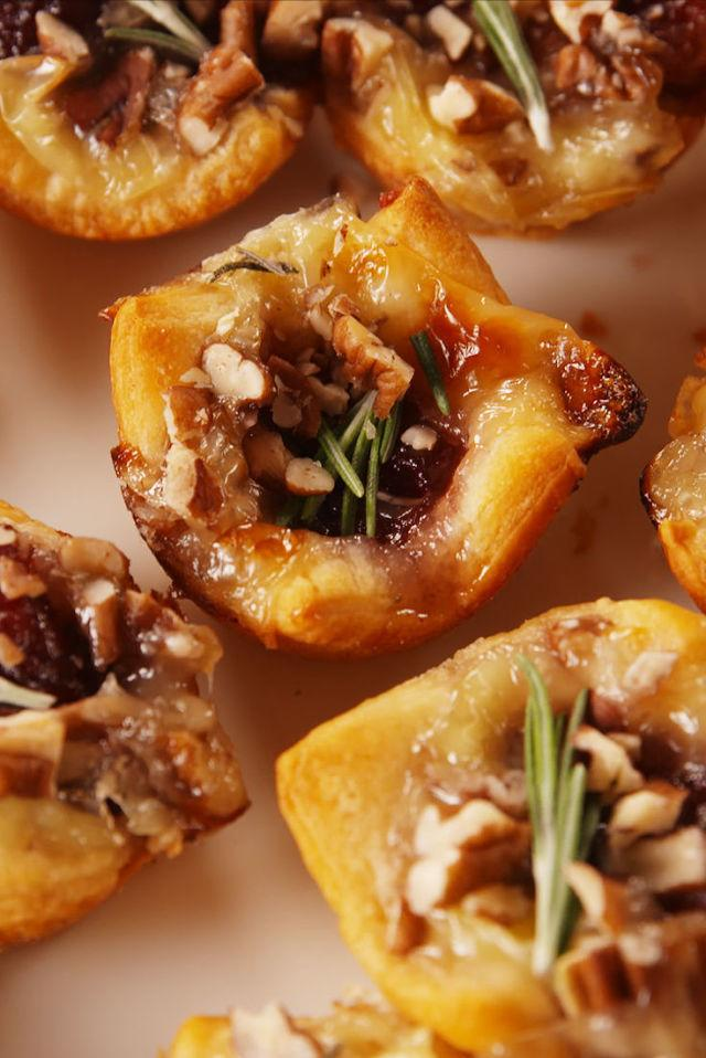 "<p>The perfect party appetizer.</p><p>Get the recipe from <a rel=""nofollow"" href=""http://www.delish.com/cooking/recipe-ideas/recipes/a56610/cranberry-brie-bites-recipe/"">Delish</a>.</p><p><strong><em>BUY NOW: Mini Muffin Tin, $22.95, <a rel=""nofollow"" href=""https://www.amazon.com/Bakers-Advantage-Nonstick-Muffin-24-Cup/dp/B00PCHQUV4/ref=sr_1_1?tag=syndication-20&s=kitchen&ie=UTF8&qid=1510259137&sr=1-1&keywords=mini+muffin+tin&&ascsubtag=[artid"">amazon.com</a>.</em></strong></p>"