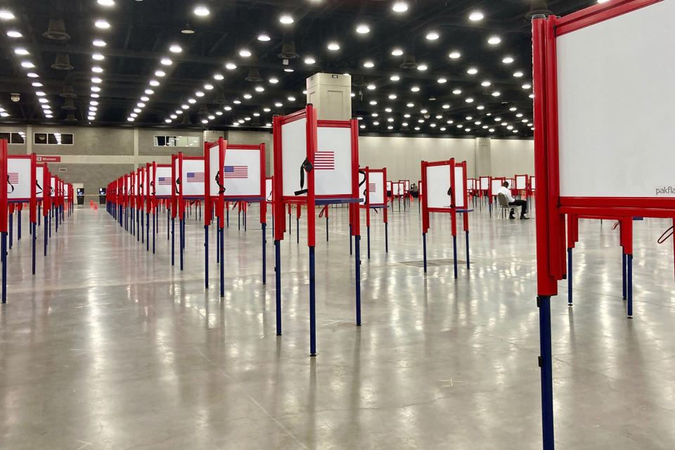 FILE - This June 22, 2020, file photo shows voting stations set up for the primary election at the Kentucky Exposition Center in Louisville, Ky. Voting will look a little different this November. States are considering drive-thrus, outdoor polling places and curbside voting as they examine creative ways to safely offer same-day polling places during a pandemic. (AP Photo/Piper Blackburn, File)