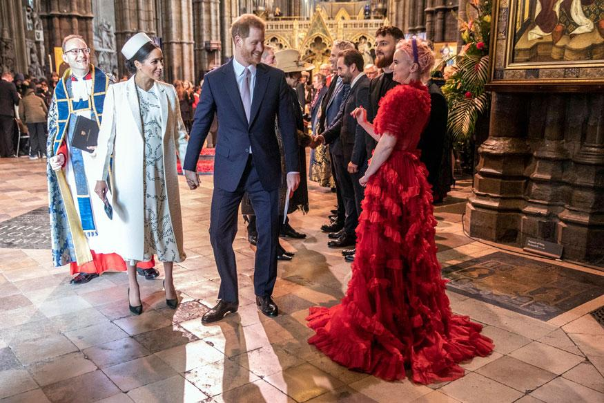 "Britain's Prince Harry and Meghan, the Duchess of Sussex talk with Grace Chatto part of the group ""Clean Bandit"" who performed as they attend the Commonwealth Service with other members of the Royal family at Westminster Abbey in London. (Image: AP)"