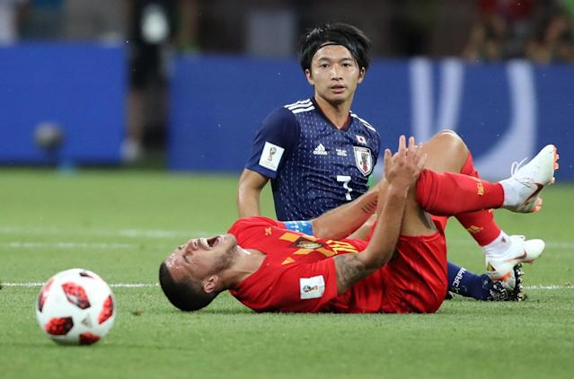 <p>Belgium's Eden Hazard goes down after a challenge by Japan's Gaku Shibasaki REUTERS/Marko Djurica </p>