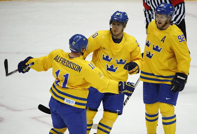 Sweden forward Alexander Steen, center, celebrates his first period goal against Slovenia with forward Daniel Alfredsson, left, and forward Gabriel Landeskog during a men's quarterfinal ice hockey game at the 2014 Winter Olympics, Wednesday, Feb. 19, 2014, in Sochi, Russia. (AP Photo/Mark Humphrey)