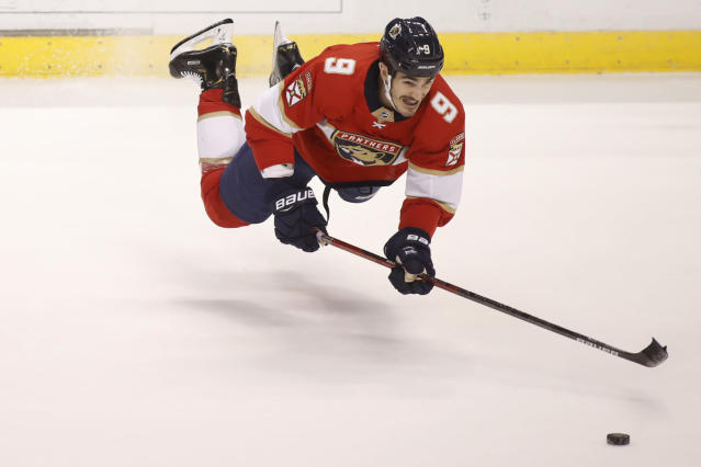 Florida Panthers' Brian Boyle reaches for the puck during the first period of the team's NHL hockey game against the Dallas Stars, Friday, Dec. 20, 2019, in Sunrise, Fla. (AP Photo/Luis M. Alvarez)