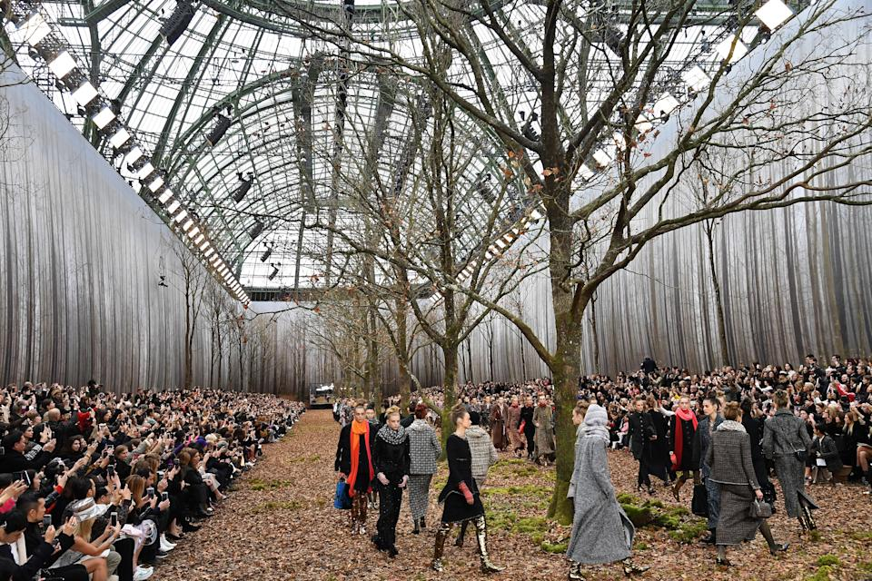 <p>Models trod through mountains of crispy leaves to debut 80 of Karl Lagerfeld's autumn-ready looks back in March 2018. A stark contrast to the Parisian spring, the Grand Palais was transformed into a woodland and we'd never looked forward to winter more… <em>[Photo: Getty]</em> </p>