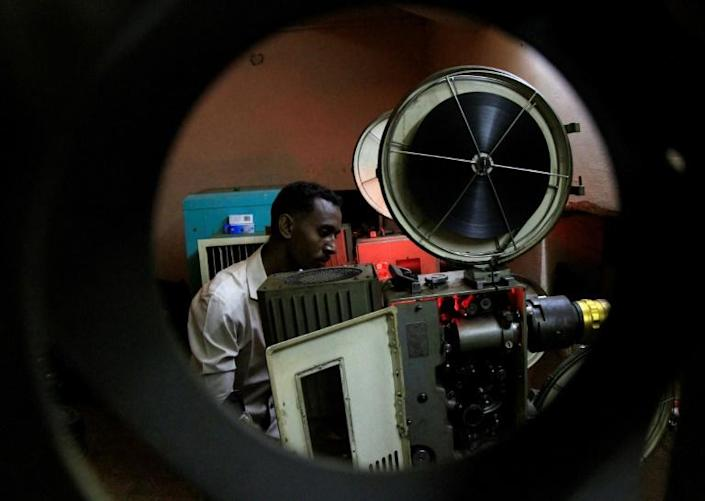 In this picture from 2014, a Sudanese man prepares a film for projection at The Palace of Youth and Children, one of just three functioning cinemas left in the area around the capital Khartoum at the time