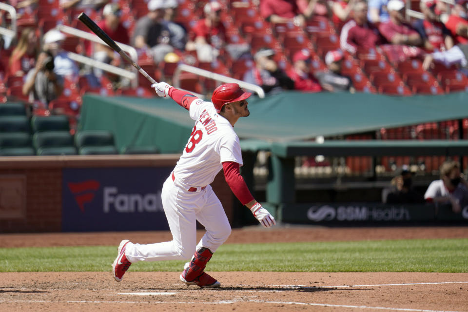 St. Louis Cardinals' Nolan Arenado doubles during the sixth inning of a baseball game against the Washington Nationals Wednesday, April 14, 2021, in St. Louis. (AP Photo/Jeff Roberson)