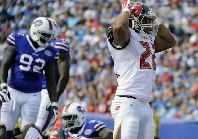 Tampa Bay Buccaneers running back Doug Martin (22) celebrates after scoring a touchdown during the first half of a preseason NFL football game against the Buffalo Bills Saturday, Aug. 23, 2014, in Orchard Park, N.Y. (AP Photo/Gary Wiepert)