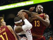 Atlanta Hawks forward Josh Smith (5) and Cleveland Cavaliers forward Tristan Thompson (13) fight for a rebound during the first half of an NBA basketball game, Friday, Nov. 30, 2012, in Atlanta. (AP Photo/John Bazemore)