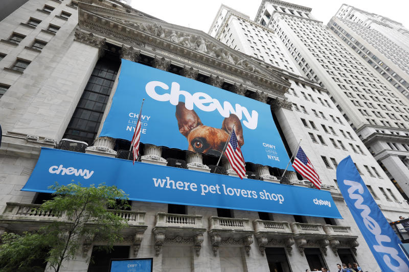 The facade of the New York Stock Exchange is decorated for the Chewy IPO, Friday, June 14, 2019. Chewy, the online seller of pet food and squeaky toys, went public Friday and its shares soared 71%. (AP Photo/Richard Drew)