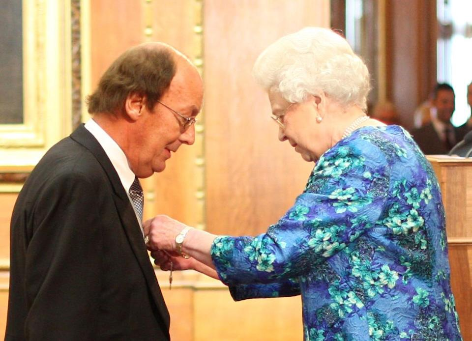 TV Presenter Fred Dinenage during an Investiture ceremony at Windsor Castle where he was made a Member of the British Empire (MBE) by Queen Elizabeth II.