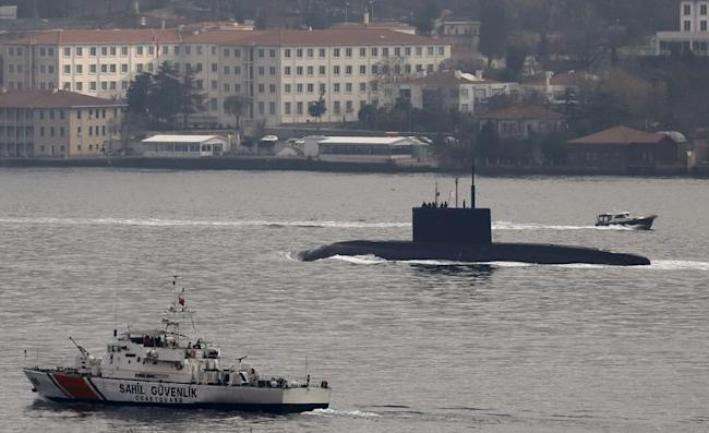 Russia's diesel-electric submarine Rostov-on-Don is escorted by a Turkish Navy Coast Guard boat as it sets sail in the Bosphorus, on its way to the Black Sea, in Istanbul, Turkey, December 13, 2015. REUTERS/Murad Sezer