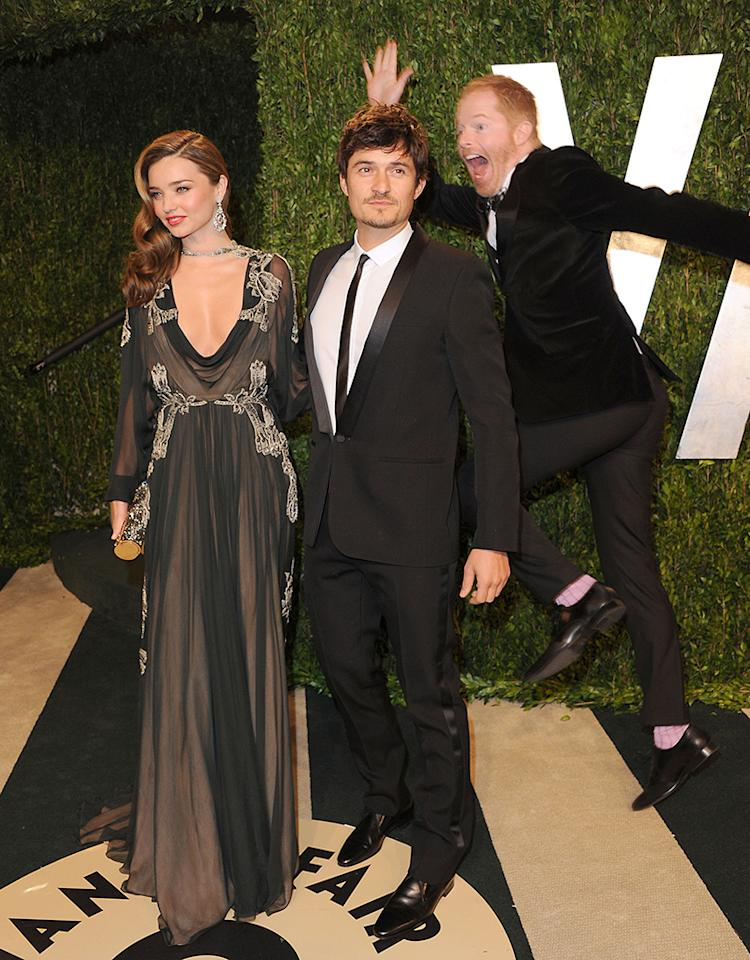 WEST HOLLYWOOD, CA - FEBRUARY 24: Miranda Kerr, Orlando Bloom and Jesse Tyler Ferguson attend the 2013 Vanity Fair Oscar party at Sunset Tower on February 24, 2013 in West Hollywood, California.  (Photo by Jon Kopaloff/FilmMagic)