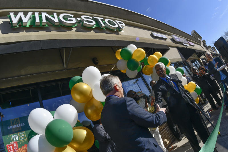 IMAGE DISTRIBUTED FOR WINGSTOP - Wingstop celebrates the milestone opening of its 1,000th restaurant as Wingstop Chief Executive Officer Charlie Morrison introduces U.S. Representative Hank Johnson, right, during a ribbon cutting ceremony on Thursday, Jan. 26, 2017, in Decatur, Ga. (John Amis/AP Images for Wingstop)