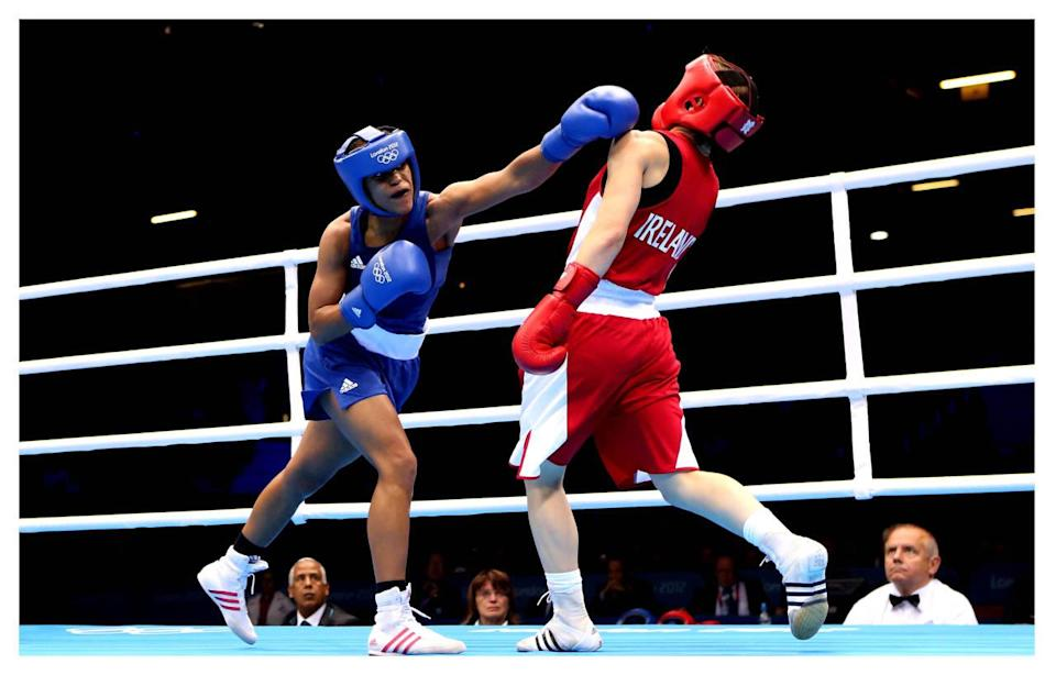 <p>Boxing uniforms are also pretty in the middle, but the added headgear and, of course, gloves add another layer of dress to the sport.</p><p><i>(Photo: Getty Images)</i><br></p><p><br></p>