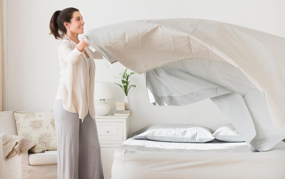 As a general guideline, before the coronavirus pandemic, it was a good idea to wash bed sheets once a week. Experts suggest doubling that frequency now. (Photo: Tetra Images via Getty Images)
