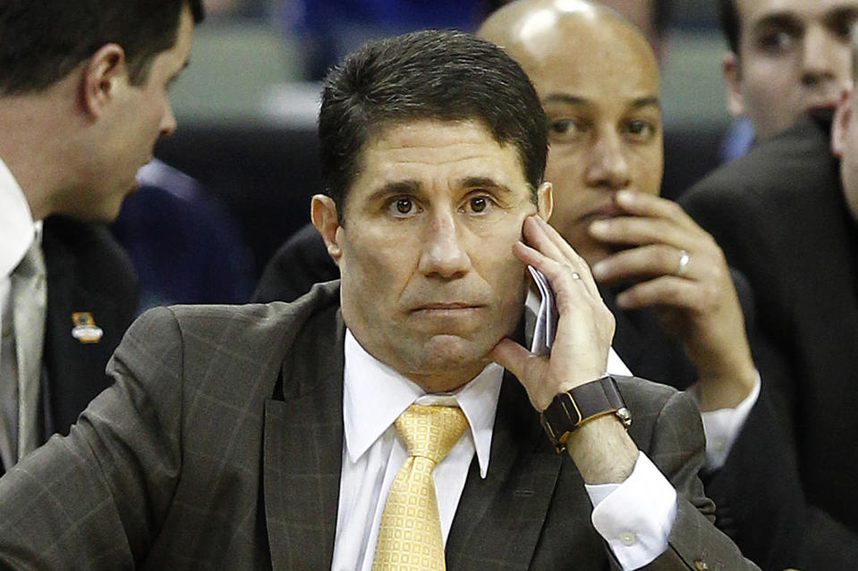 """FILE - In this March 20, 2010, file photo, then-Wake Forest head coach Dino Gaudio watches during an NCAA college basketball game against Kentucky in New Orleans. Gaudio, a former University of Louisville basketball assistant, pleaded guilty Friday, June 4, 2021, to a federal charge of attempted extortion and will avoid prison time. Gaudio threatened to expose alleged violations by the Louisville team """"in its production of recruiting videos for prospective student-athletes and in the use of its graduate assistants in practices,"""" according to a charging document filed in May. He asked for 17 months of salary or a $425,000 lump sum payment, according to the U.S. Attorney. (AP Photo/Patrick Semansky, File)"""
