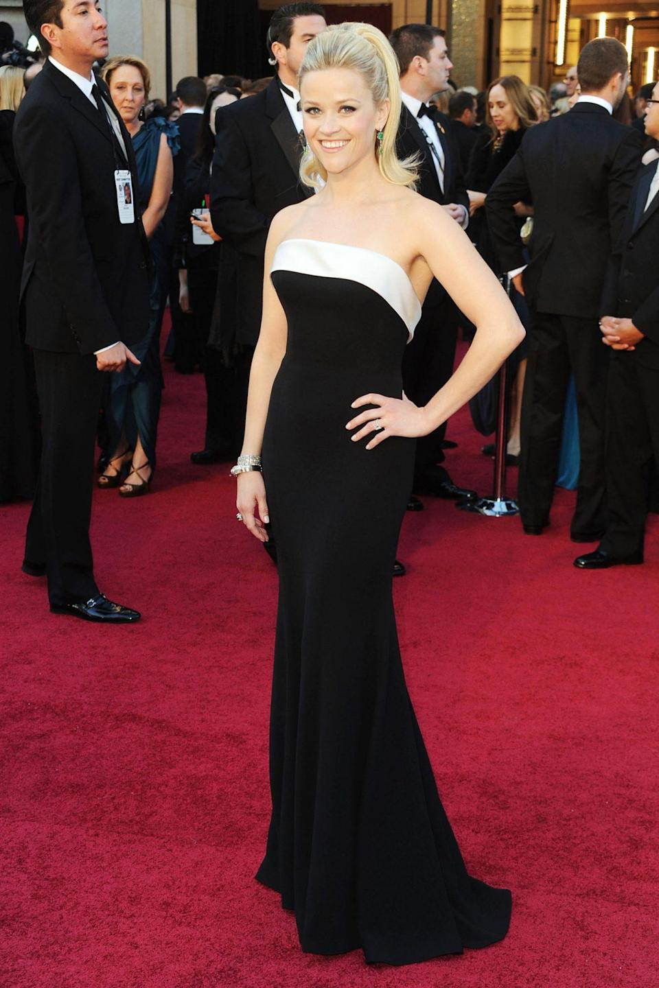 <p>Reese Witherspoon's black-and-white strapless Armani Privé gown paired with her high ponytail became an instantly iconic look. </p>