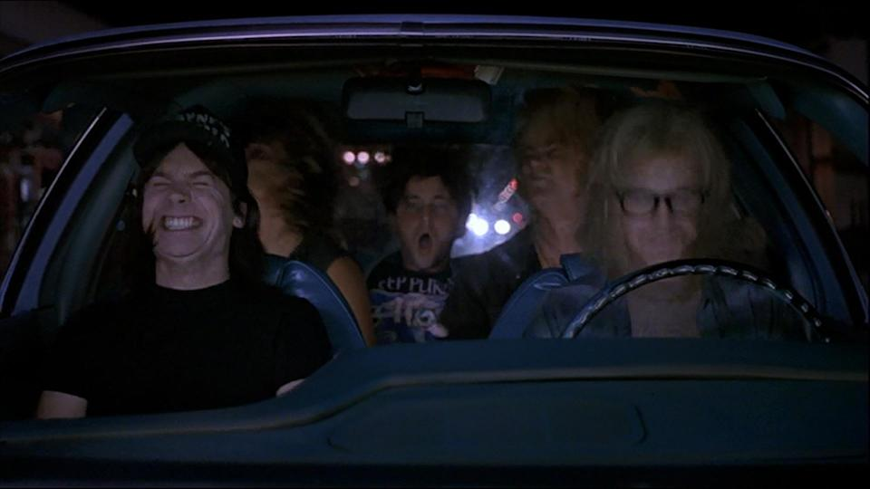 <p>The defining moment of Wayne's World and another scene that forever changed a classic rock tune for an entire generation: every time this song is played, look around the room and see how many people start rocking their heads when the Brian May riff kicks in. Iconic. (Credit: Paramount Pictures) </p>