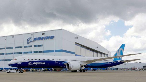 PHOTO: Boeing employees stand near the new Boeing 787-10 Dreamliner at the company's facility in South Carolina after conducting its first test flight at Charleston International Airport in North Charleston, S.C., March 31, 2017. (Mic Smith/AP, FILE)