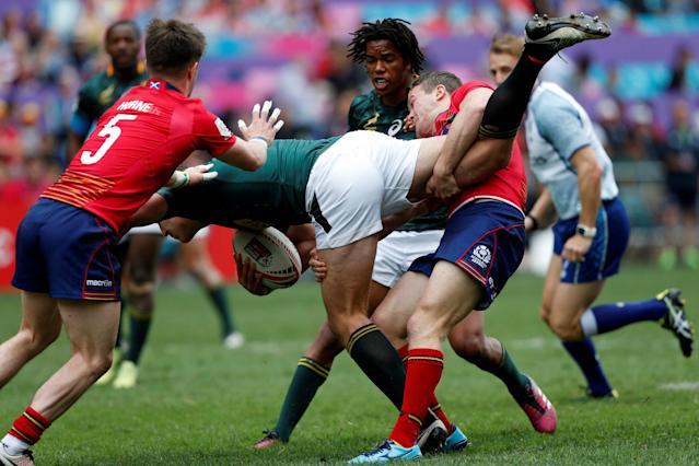 Rugby Union - Hong Kong Sevens - South Africa v Scotland - Hong Kong Stadium, Hong Kong, China - April 7, 2018 South Africa's James Murphy is tackled. REUTERS/Bobby Yip