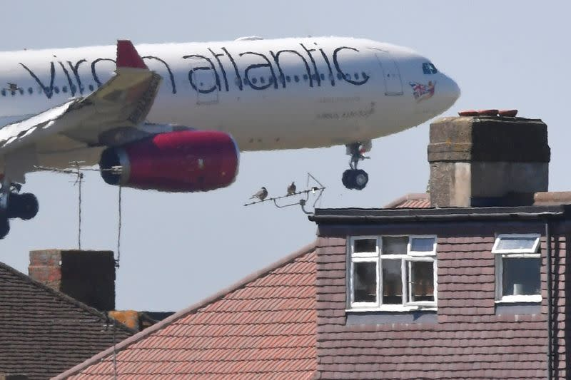 A Virgin Atlantic Airbus comes in to land at Heathrow aiport in London