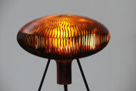 This photo provided by .MGX by Materialise shows the Russula.MGX table lamp by Arik Levy, from the design division of Belgium-based 3-D printing company, Materialise. It takes its name and shape from a mushroom, appearing to float and hover in space thanks to a slender supporting structure. A novelty once reserved for science-fiction, 3-D printing has gone mainstream in home decor thanks to cheaper, more accessible technology. (AP Photo/.MGX by Materialise)