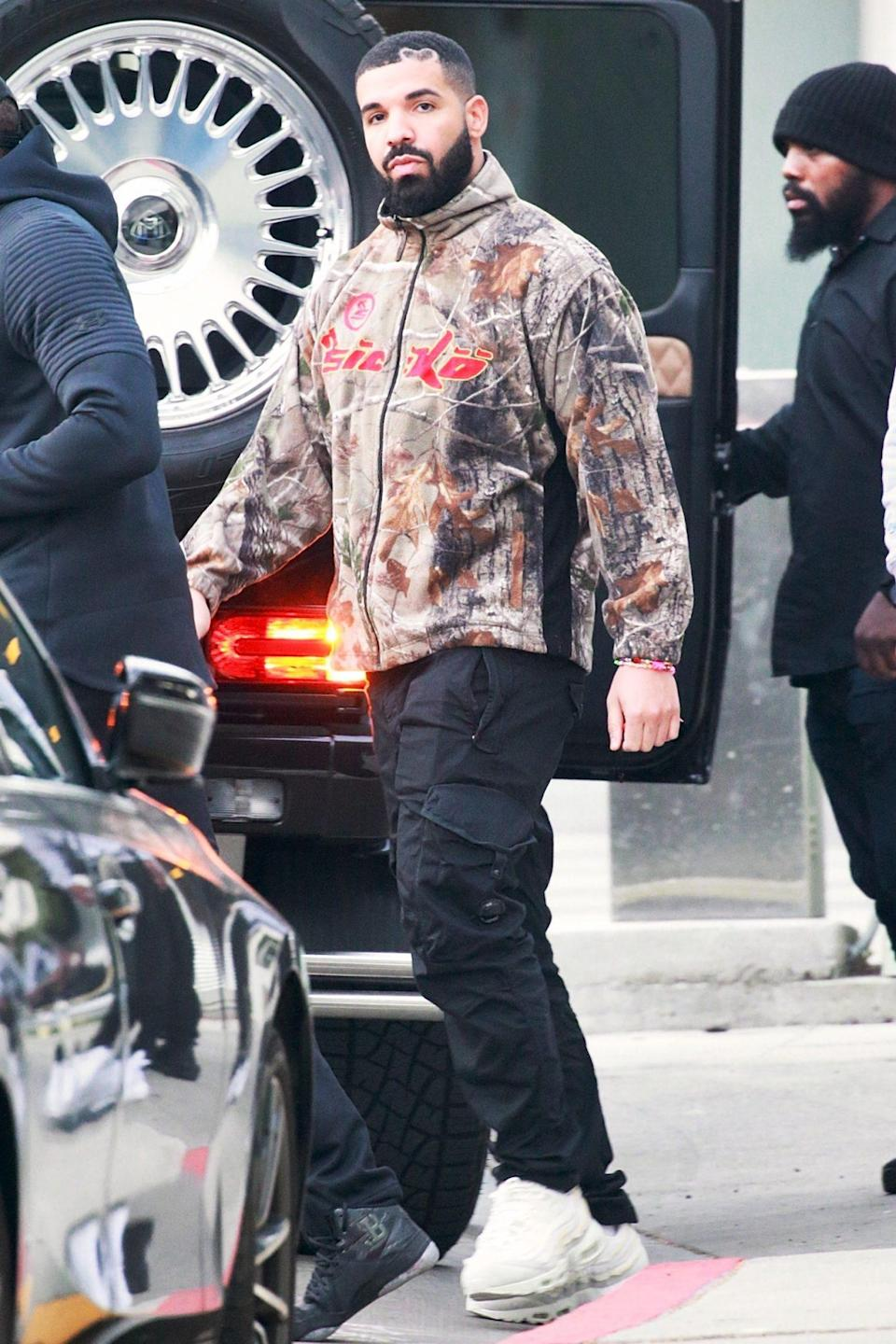 <p>Drake leaves the studio with security and friends in West Hollywood on Thursday. </p>