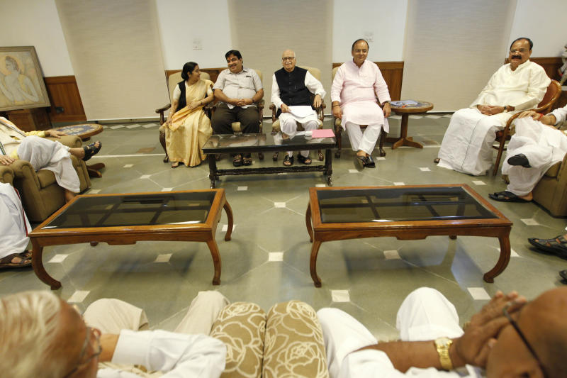 Hindu nationalist Bharatiya Janata Party leaders, left to right, Sushma Swaraj, Nitin Gadkari, Lal Krishna Advani , Arun Jaitley and and Venkaiah Naidu meet after Ayodhya verdict, in New Delhi, India, Thursday, Sept. 30, 2010. An Indian court ruled Thursday that a disputed holy site that has sparked bloody communal riots across the country in the past should be divided between the Hindu and Muslim communities. (AP Photo/Saurabh Das)