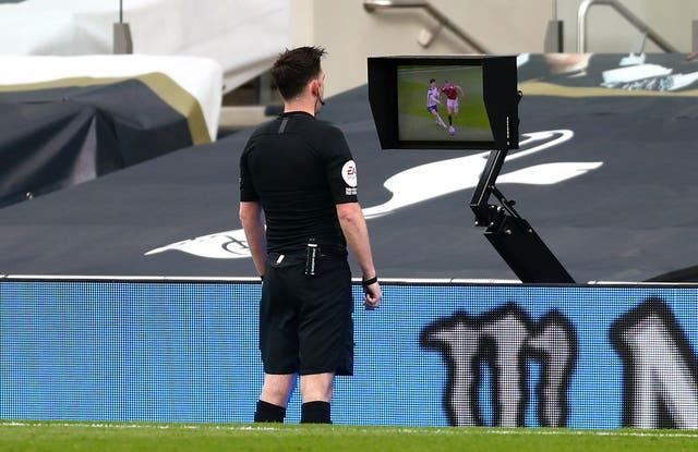 Referee Chris Kavanagh looked at the pitchside monitor before disallowing Cavani's goal