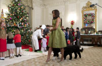 <p>The White House decor for 2015 is bigger and better than ever before. There are 62 Christmas trees, more than 70,000 ornaments, and hip fashion designer-decorated rooms. So to celebrate, the first lady wore her best holiday dress. a green fit-and-flare frock from Michael Kors, which she paired with metallic pumps. <i>Photo: AP</i></p>