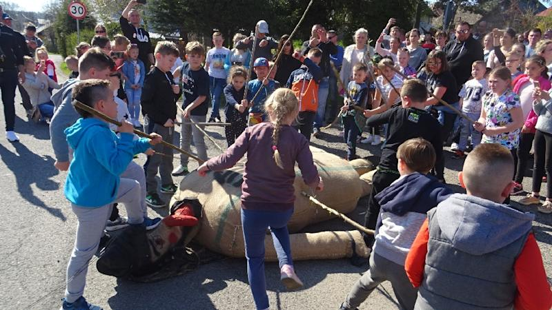Children beat an effigy of Judas on Good Friday in the town of Pruchnik, Poland (AFP Photo/Hubert Lewkowicz)