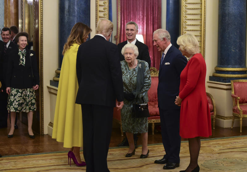 Princess Anne, Princess Royal (Left) watches as Queen Elizabeth II talks to US President Donald Trump and wife Melania at a reception for NATO leaders at Buckingham Palace.