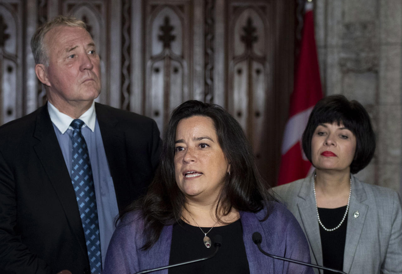 <p> Minister of Justice and Attorney General of Canada Jody Wilson-Raybould speaks during a press conference as Minister of Health Ginette Petitpas Taylor, right, and Parliamentary Secretary to the Minister of Justice and Attorney General of Canada and to the Minister of Health Bill Blair, left, look on during a press conference on Bill C-45, the Cannabis Act, in the Foyer of the House of Commons on Parliament Hill in Ottawa, Ontario on Wednesday, June 20, 2018. The Canadian government said it will soon announce the date of when cannabis will become legal — but warns it will remain illegal until then. (Justin Tang/The Canadian Press via AP) </p>