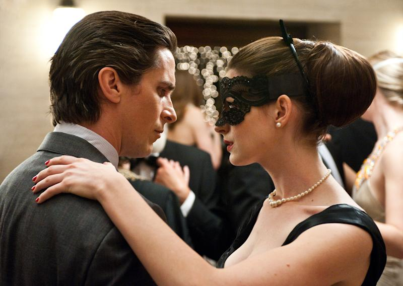 """This undated film image released by Warner Bros. Pictures shows Christian Bale as Bruce Wayne, left, and Anne Hathaway as Selina Kyle in a scene from the action thriller """"The Dark Knight Rises."""" (AP Photo/Warner Bros. Pictures, Ron Phillips)"""