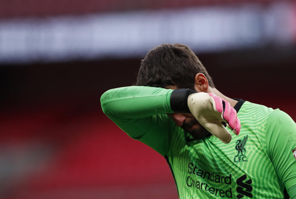Liverpool goalkeeper Alisson Becker reacts during the penalty shootout during the English FA Community Shield soccer match between Arsenal and Liverpool at Wembley stadium in London, Saturday, Aug. 29, 2020. (Andrew Couldridge/Pool via AP)