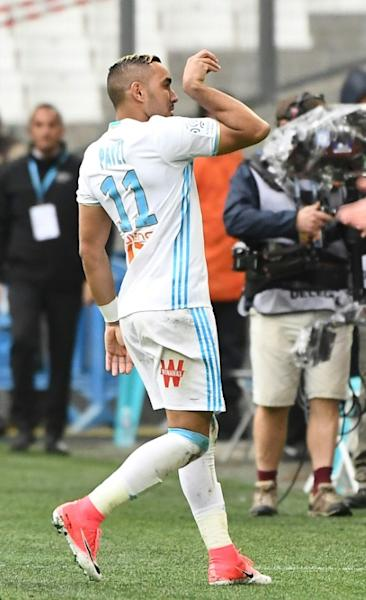Marseille's Dimitri Payet gestures after scoring against Dijon at the Velodrome stadium in Marseille on April 1, 2017