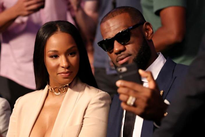 NBA player Lebron James and wife Savannah Brinson attends the super welterweight boxing match between Floyd Mayweather Jr. and Conor McGregor on August 26, 2017 at T-Mobile Arena in Las Vegas, Nevada. (Photo by Christian Petersen/Getty Images)