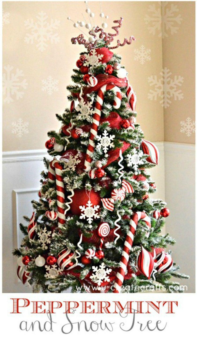 """<p>Try a fresh look this season by adorning your tree with giant sparkling candy canes.</p><p><em><strong>Get the tutorial at </strong><strong><a href=""""http://www.u-createcrafts.com/peppermint-snow-christmas-tree-revealed/"""" rel=""""nofollow noopener"""" target=""""_blank"""" data-ylk=""""slk:U Create Crafts."""" class=""""link rapid-noclick-resp"""">U Create Crafts.</a></strong></em></p><p><a class=""""link rapid-noclick-resp"""" href=""""https://www.amazon.com/dp/B077MRVNV9/?tag=syn-yahoo-20&ascsubtag=%5Bartid%7C10070.g.2025%5Bsrc%7Cyahoo-us"""" rel=""""nofollow noopener"""" target=""""_blank"""" data-ylk=""""slk:BUY CANDY CANE ORNAMENTS"""">BUY CANDY CANE ORNAMENTS</a> </p>"""