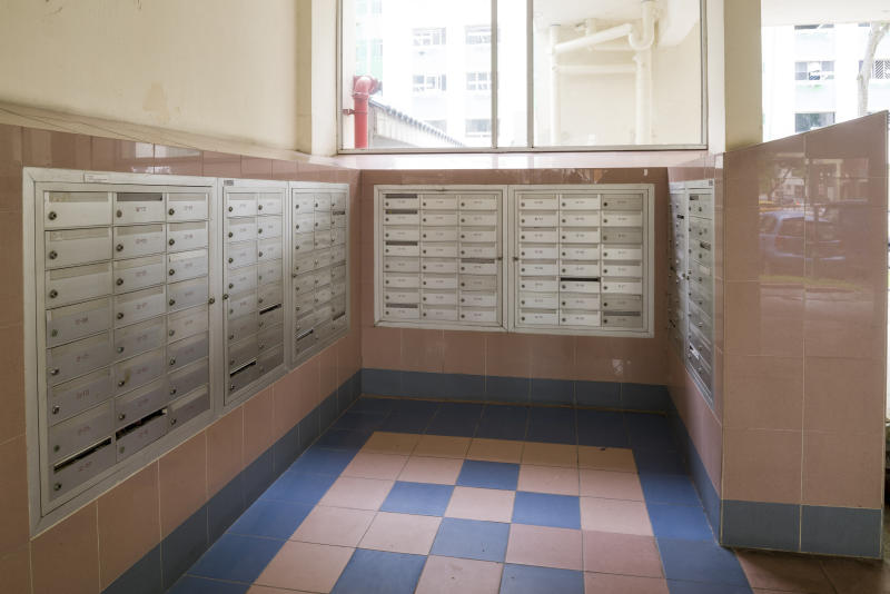 """Singapore, Singapore -"""" May 26, 2013: Letter box area of public housing flats at Tampines New Town. Residents receive letters and numinous advertising flyers from their letter box."""