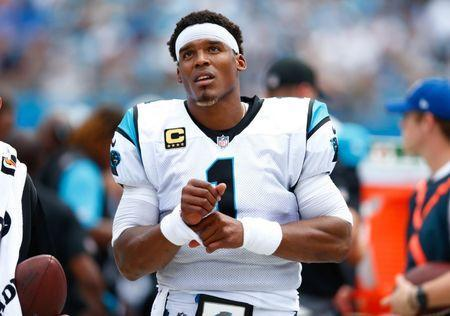 Sep 24, 2017; Charlotte, NC, USA; Carolina Panthers quarterback Cam Newton (1) watches the game on the big screen from the sidelines during the second quarter at Bank of America Stadium. Mandatory Credit: Jeremy Brevard-USA TODAY Sports