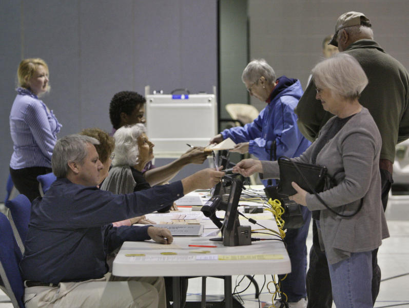 Voters in Cobb County, one of the largest precincts in the state, participate in the Georgia GOP primary on Tuesday, March 6, 2012, at Noonday Baptist Church in Marietta, Ga. Republican Presidential candidate Former House Speaker Newt Gingrich was favored to win in Georgia on Tuesday, but his rivals have spent time and resources in the state, hoping to grab a share of the state's 76 delegates.(AP Photo/Atlanta Journal & Constitution, Bob Andres) MARIETTA DAILY OUT; GWINNETT DAILY POST OUT