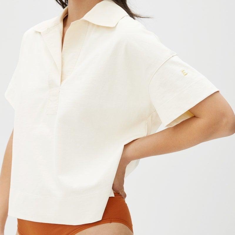 """<br><br><strong>Everlane</strong> The Retro Jersey Polo, $, available at <a href=""""https://go.skimresources.com/?id=30283X879131&url=https%3A%2F%2Fwww.everlane.com%2Fproducts%2Fwomens-retro-jersey-polo-canvas"""" rel=""""nofollow noopener"""" target=""""_blank"""" data-ylk=""""slk:Everlane"""" class=""""link rapid-noclick-resp"""">Everlane</a>"""