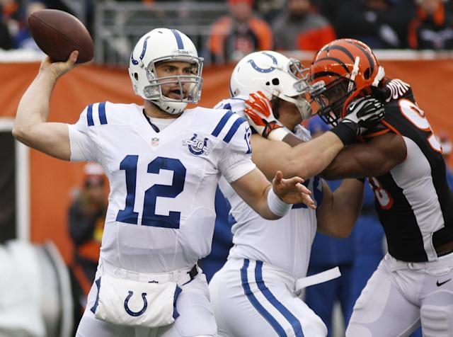 Indianapolis Colts quarterback Andrew Luck (12) passes against the Cincinnati Bengals in the first half of an NFL football game, Sunday, Dec. 8, 2013, in Cincinnati. (AP Photo/David Kohl)