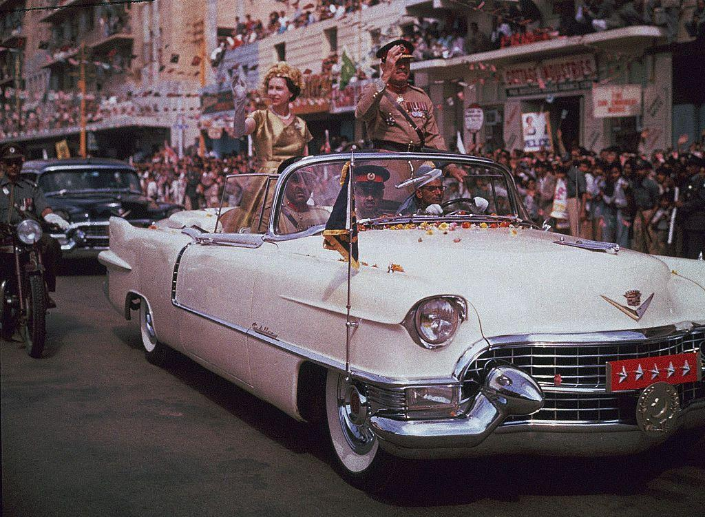 <p>Queen Elizabeth waved to the crowds as she rode in a convertible through the streets of Karachi. </p>