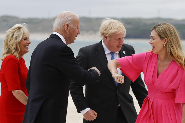 Britain's Prime Minister Boris Johnson and his spouse Carrie Johnson greet U.S. President Joe Biden and first lady Jill Biden during arrivals for a G7 meeting at the Carbis Bay Hotel in Carbis Bay, St. Ives, Cornwall, England, Friday, June 11, 2021. Leaders of the G7 begin their first of three days of meetings on Friday, in which they will discuss COVID-19, climate, foreign policy and the economy. (Phil Noble, Pool via AP)