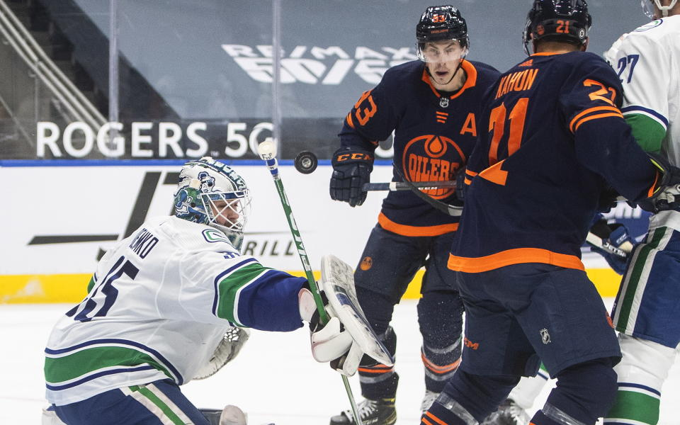 Edmonton Oilers' Ryan Nugent-Hopkins (93) is stopped by Vancouver Canucks goalie Thatcher Demko (35) during second-period NHL hockey game action in Edmonton, Alberta, Saturday, May 15, 2021. (Jason Franson/The Canadian Press via AP)