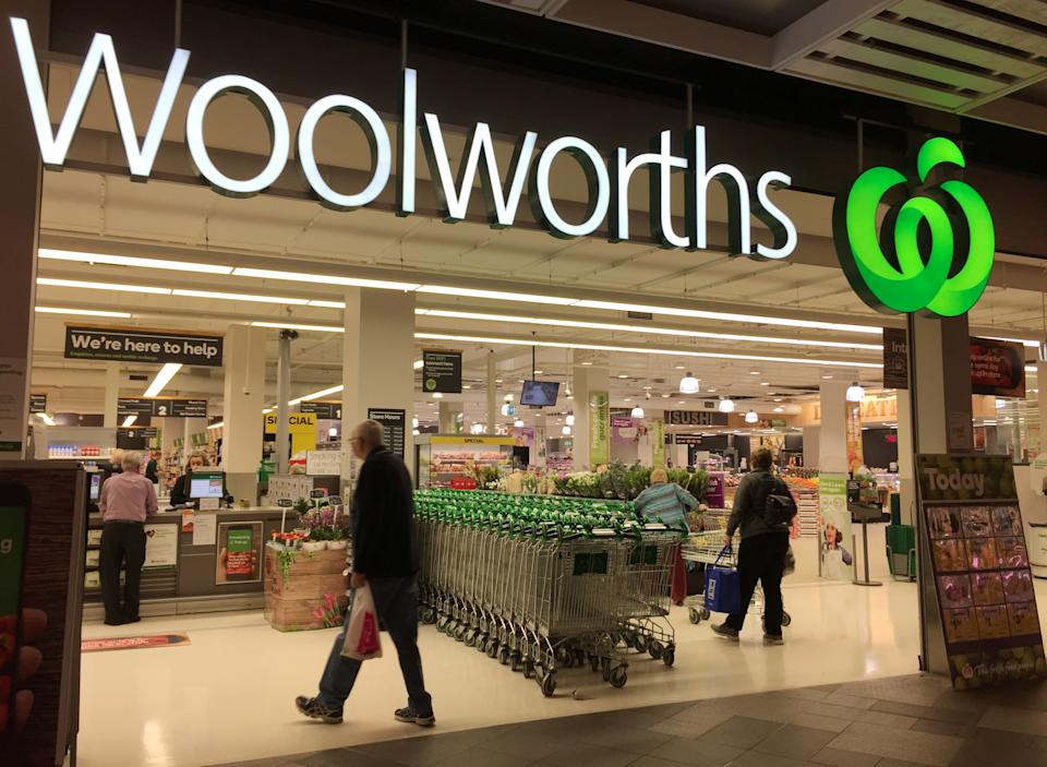 Shoppers walk into a Woolworths supermarket. Source: Reuters