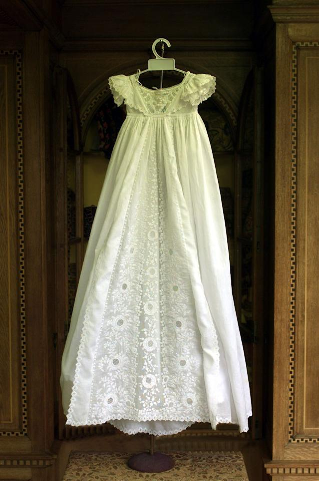<p>Diana is born on July 1, 1961 and wears this 19th century gown for her christening. It was displayed in summer 1999 at Althorp, the Spencer family's estate near Northampton.<br></p>