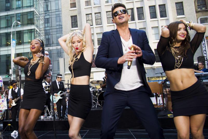 "FILE - This July 30, 2013 file photo shows Robin Thicke performing on NBC's ""Today"" show in New York. An attorney for Thicke and collaborator Pharrell Williams filed a lawsuit Thursday, Aug. 16, 2013, in Los Angeles, asking a federal judge to determine that the pair's hit song ""Blurred Lines"" does not copy elements from two older songs by Marvin Gaye and George Clinton. (Photo by Charles Sykes/Invision/AP, File)"